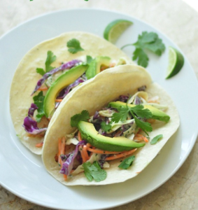 Fish tacos with cabbage slaw and avocado